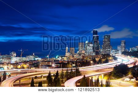 traffic on city road and cityscape of seattle at night