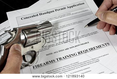 Man with pistol and handgun permit application