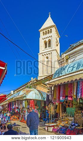 JERUSALEM ISRAEL - FEBRUARY 16 2016: The white stone belfry of the Lutheran Kirche rises over the stalls of the Aftimos Suq on February 16 in Jerusalem.