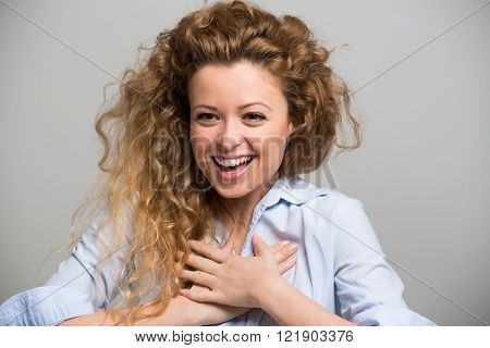 Portrait of an amazed and happy woman