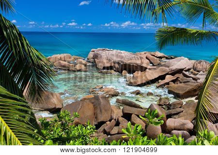 Beautiful little secluded beach at tropical La Digue island in Seychelles