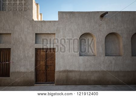 Facade of an old Arabic house. Old arabian architecture.