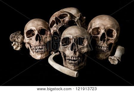 Human skull and bones, genocides concept and horror darkness