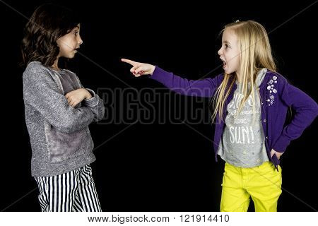 Girl pointing accusing finger at cute friend