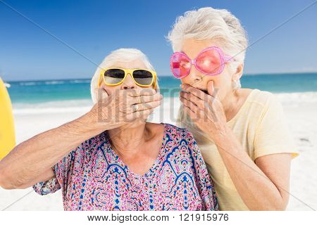 Portrait of surprised senior woman on the beach