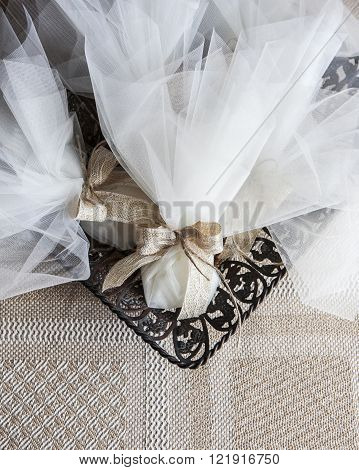 veiling wedding favors in to a metal tray