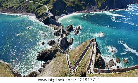 A top down view of the winding path climbing to the monastery of San Juan de Gaztelugatxe, in the Spanish Basque country.