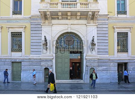 ATHENS GREECE - MAY 04: National Bank of Greece in Athens on MAY 04 2015. People in Front of National Bank of Greece Headquaters Building in Athens Greece.
