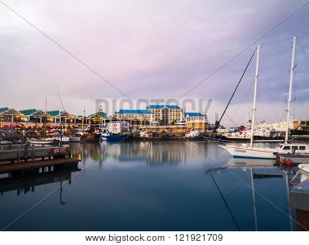 CAPE TOWN SOUTH AFRICA - FEBRUARY 19 2016: Most famous landmark in Cape Town, South Africa, the Waterfront, at sunset.