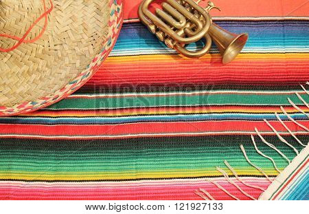 Mexico Poncho Background copy space trumpet and sombrero