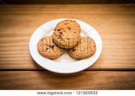 Chocolate chips cookies on the white dish background
