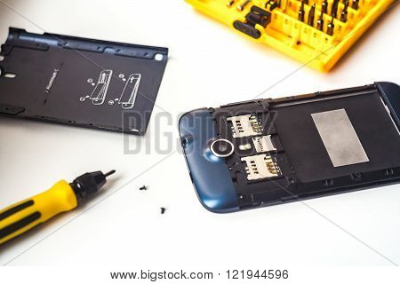 Mobile phone repairing process close up shot