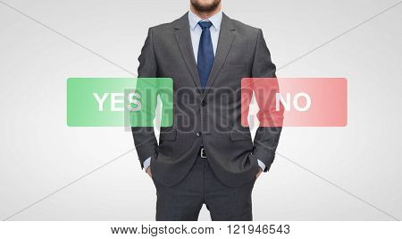 business, choice, election and people concept - close up of businessman in suit with yes and no buttons