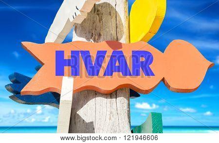 Hvar signpost with beach background