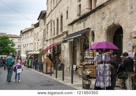AVIGNON FRANCE - MAY 04 2015: Street scene in historical centre of Avignon. Avignon is a famous and very popular city in Provence in south of France