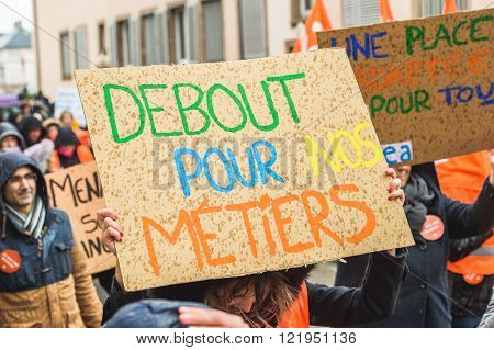 STRASBOURG FRANCE - MAR 15 2016: Start for our profession placards as hundreds protests against Bas-Rhin Alsace departmental budget cuts for 2016 requesting no cuts and wage increase