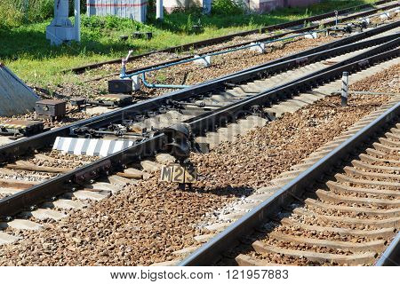 railway shunting arrows and traffic light in summer