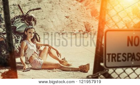 Sexy Biker Woman With The Gun