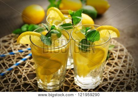 Group of lemonades with lemon and mint on stand