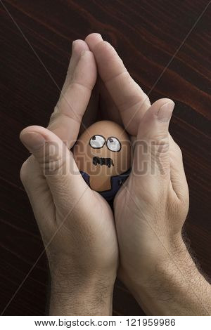 Concierge egg face in house like man hand