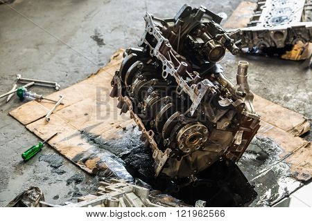Old car engine under repair showing its camshaft