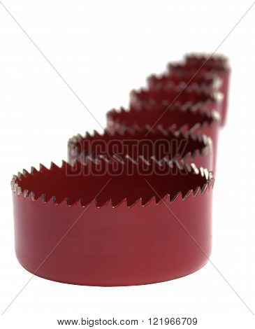 Set crown's for drilling round holes in drywall and wood on a white background shallow DOF