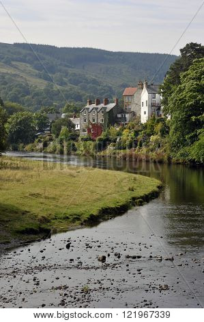 The River Dee and the village of Carrog Denbighshire Wales UK.