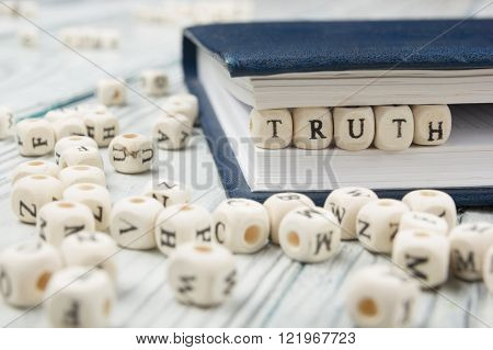 truth word background on wood blocks. Wooden Abc