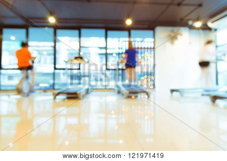 Abstract Blur Modern Fitness Center With People