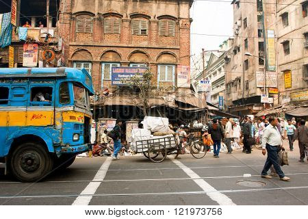 KOLKATA, INDIA - JANUARY 13: People and transport traffic on the asian street on January 13, 2013 in Kolkata India. Kolkata has a density of 814.80 vehicles per km road length