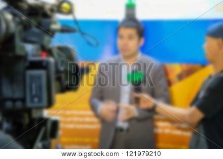 Motion blur of journalist interview an analyst