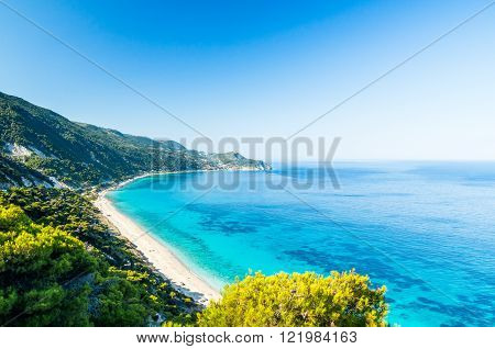 Agios Nikitas Beach. In the background it is visible the village of Agios Nikitas.