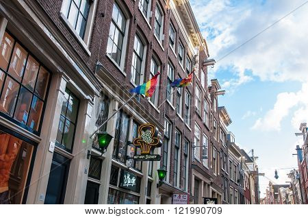 Amsterdam-April 30: Rainbow flags on the medival building in red light district on April 302015 the Netherlands.