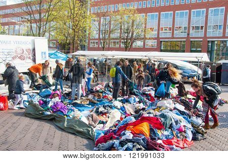 Amsterdam-April 30: Unidentified people buy clothes in a sale on daily flea market on Waterlooplein (Waterloo Square) on April 302015 the Netherlands.