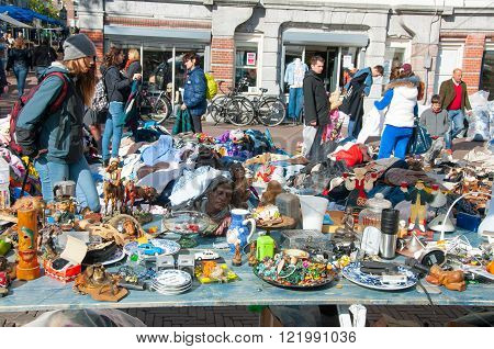 Amsterdam-April 30: Daily Flea market on Waterlooplein (Waterloo Square) merchants display curiosities and vintage for sale on April 30 2015 the Netherlands.