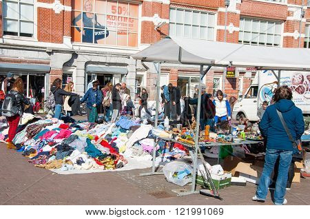 Amsterdam-April 30: People buy clothes in a sale on daily Flea market Waterlooplein (Waterloo Square) on April 30 2015 the Netherlands.