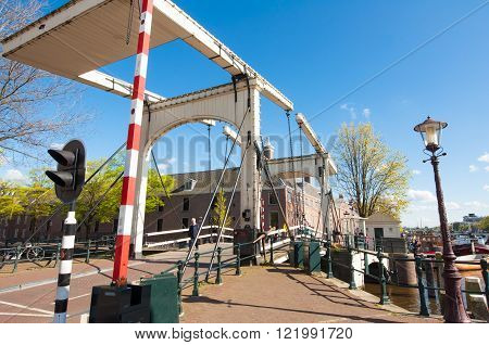 Amsterdam-April 30: Magere Brug (Skinny Bridge) on April 30 2015 Netherlands. Bridge provides a nice spot to take in sweeping views of the Amstel river with the Carré Theatre close by.