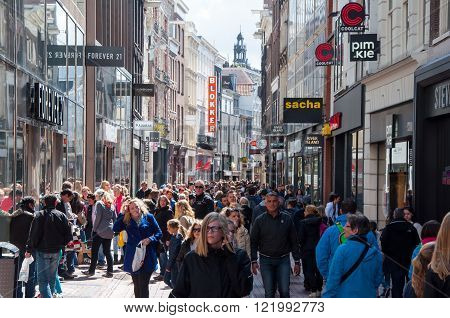 AMSTERDAM-APRIL 30: Undefined people on Kalverstraat shopping street on April 30 2015 the Netherlands. The Kalverstraat is a busy shopping street of Amsterdam the capital of the Netherlands.