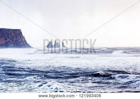 View of the famous Reynisdrangar rockformation seen from the black sand beach in Vik southern Iceland