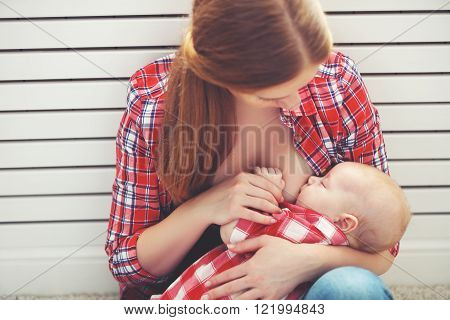 breastfeeding. mother breast feeding her baby toddler poster