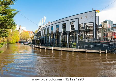 AMSTERDAM-APRIL 30: Holland Casino on the Singelgrachtkering Canal on April 302015 in Amsterdam the Netherlands. The casino features 700 slot machines 55 table games 3 bars and a brasserie.