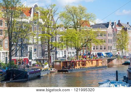 AMSTERDAM-APRIL 30: The Prinsengracht canal with houseboats on April 30,2015. Prinsengracht is the third and outermost of the three main canals: Herengracht, Prinsengracht, and Keizersgracht.