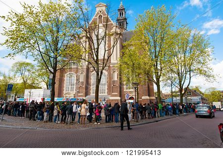 AMSTERDAM-APRIL 30: Tourists stand in a queue to get to Anne Frank House Museum on April 302015.The Anne Frank House Museum is one of Amsterdam's most popular and important museums opened in 1960.
