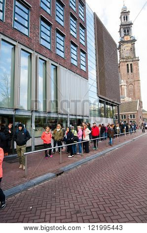 AMSTERDAM-APRIL 30: People  stand in line to visit the Anne Frank House Museum on April 30,2015.The Anne Frank House Museum is one of Amsterdam's most popular and important museums opened in 1960.
