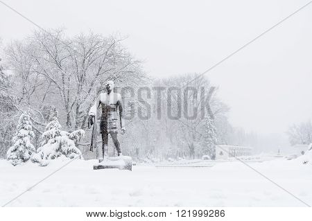 Statue Covered With Snow In Park. Charles De Gaulle Statue In Herastrau Park, Bucharest, Romania..