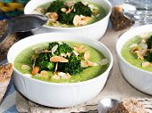 Broccoli soup in bowls for lunch with whole grain bread poster