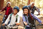 Grandparents With Children Cycling Through Fall Woodland poster
