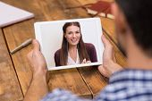 Closeup of a woman talking through video chat on tablet. Young man communicating with his girlfriend on tablet in video chat. Man looking at screen of tablet and talking with a girl through webcam. poster