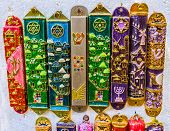 The mezuzah is affixed to the doorframe of homes in Jewish culture also popular as the protection symbol souvenir from Israel. poster