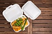Convenient but unhealthy polystyrene lunch boxes with take away meal poster